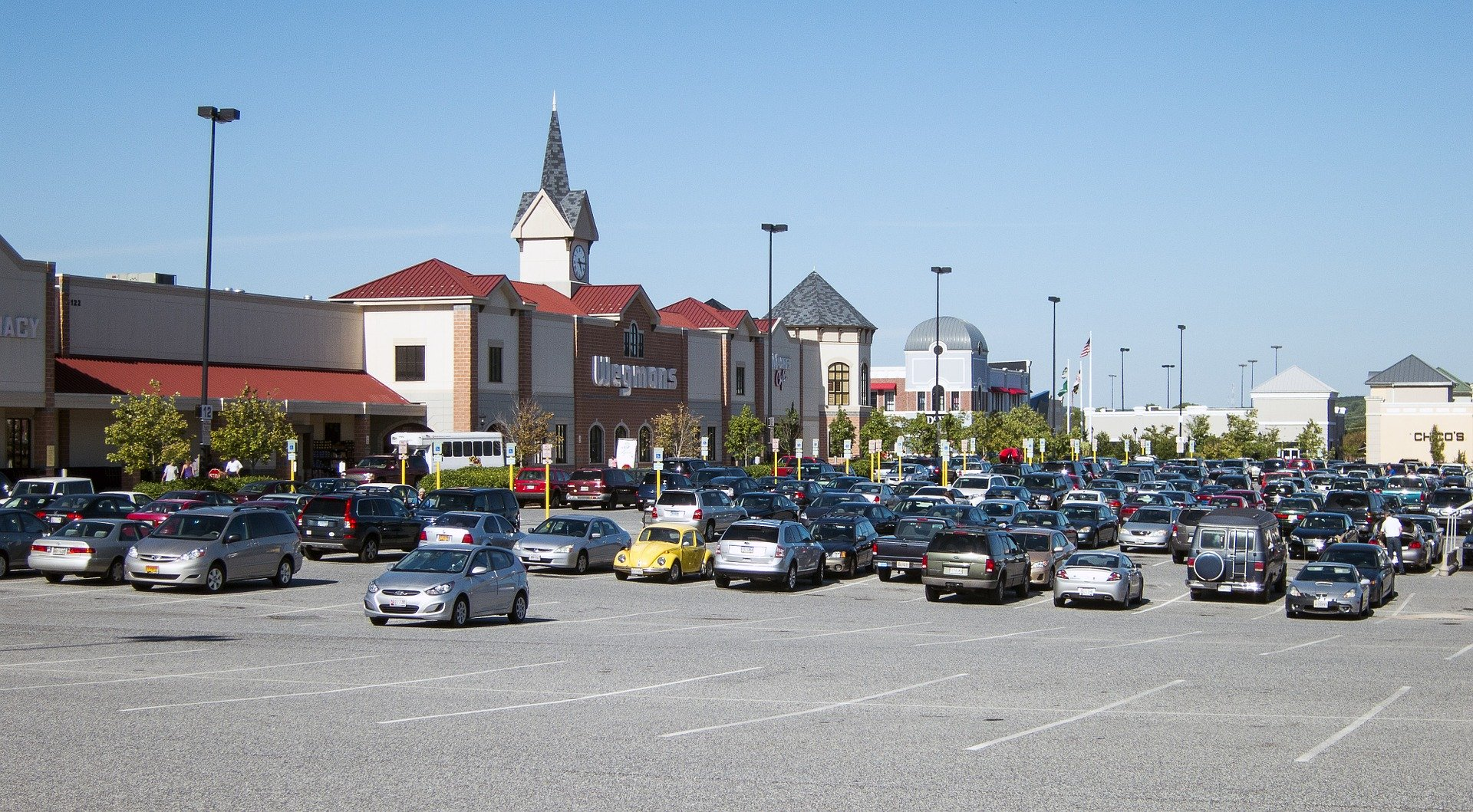 Cars parked in a shopping center parking lot