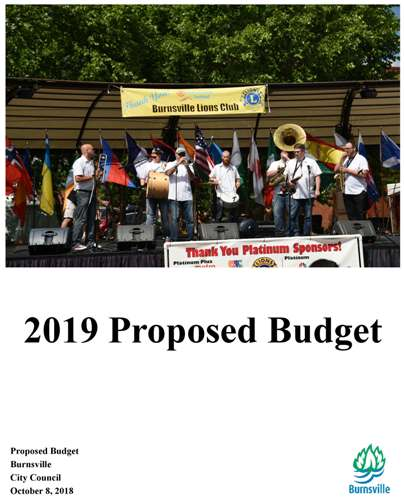 A band plays on stage during the International Festival. Text: 2019 Proposed Budget. Proposed budget Opens in new window