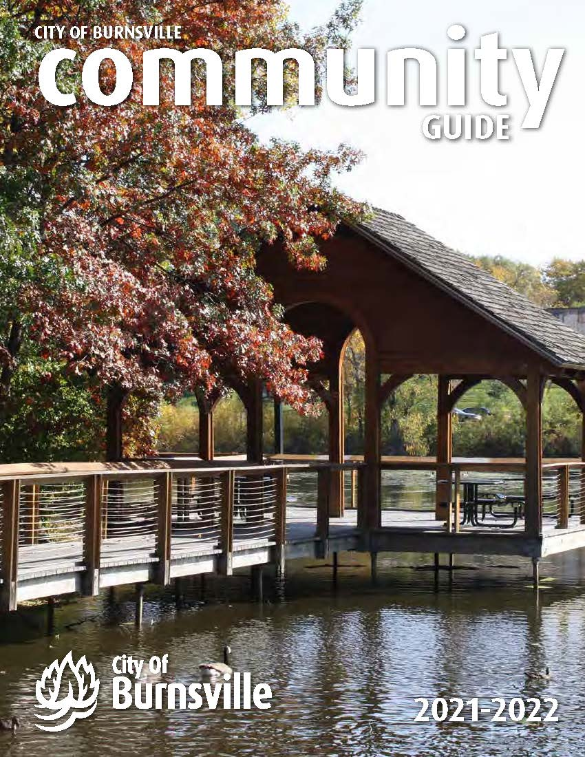 A mother and son sit on a rock next to the Minnesota River on the cover of the 2019 Community Guide Opens in new window